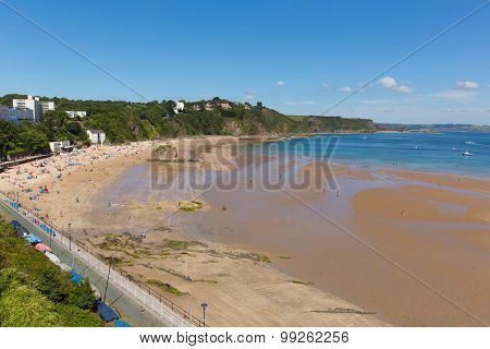 Tenby Pembrokeshire Wales uk north beach in summer with tourists and visitors and blue sky