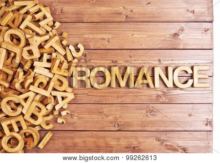 Word romance made with wooden letters