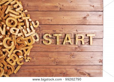 Word start made with wooden letters
