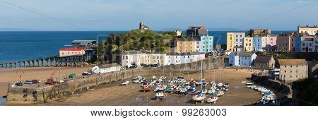 Beautiful weather and summer sunshine drew visitors to Tenby harbour and beach South Wales