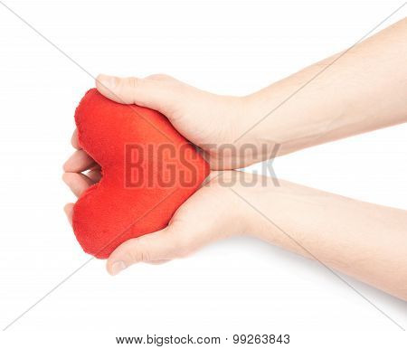Carefully holding heart with two hands