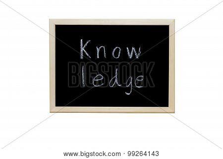 Knowledge Written With White Chalk On Blackboard.