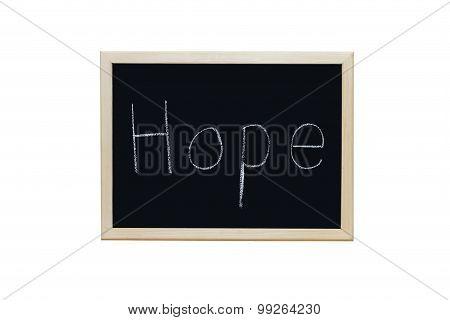 Hope Written With White Chalk On Blackboard.