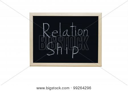 Relationship Written With White Chalk On Blackboard.