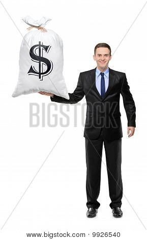 Full Length Portrait Of A  Happy Businessman Holding A Bag With Us Dollar Sign
