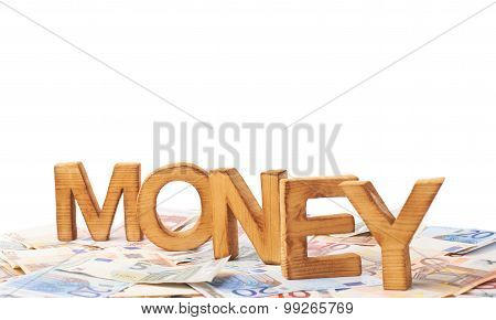 Word Money over the pile of money