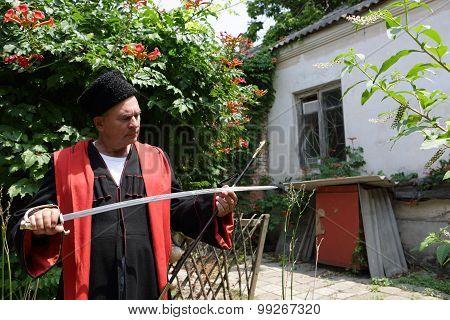Kuban Cossack Checks Blade Of Saber