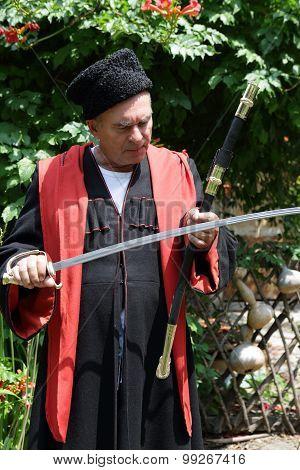 Senior Kuban Cossack Checks Blade Of Saber