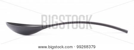 Black plastic kitchen ladle spoon isolated