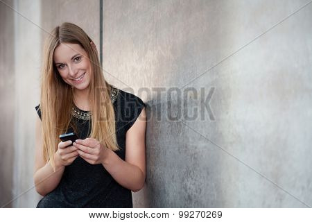 Attractive teenage girl using smart phone