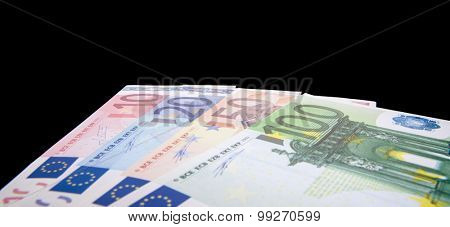 Various euro notes isolated on black background