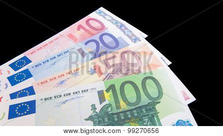 Various euro notes on black background