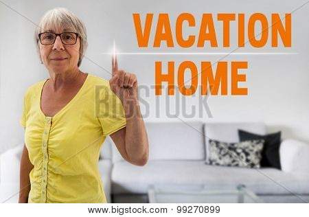 Vacation Home Touchscreen Is Shown By Senior