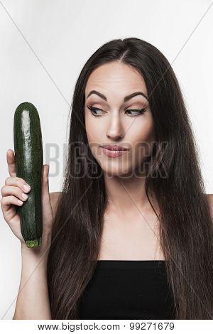 Funny Image Of Young Woman Holding Zucchini