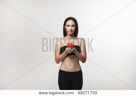 Portrait Of Young Fit Woman Holding Bell Pepper
