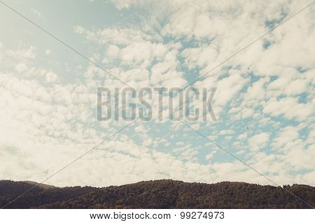 Mountains and village under the blue sky with few clouds