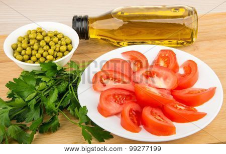 Olive Oil In Bottle, Tomatoes, Green Peas And Parsley