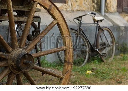 Rusty Bicycle And Wooden Wheel