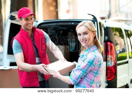 Concept of courier delivers package for woman