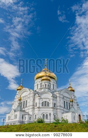 Belogorsky Cathedral. Russian Orthodox Church under blue skies. Domes covered with gold.