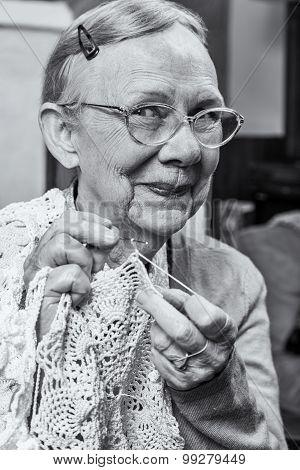 Happy Elderly Woman With Crochet