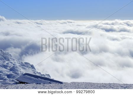 Snow clouds below