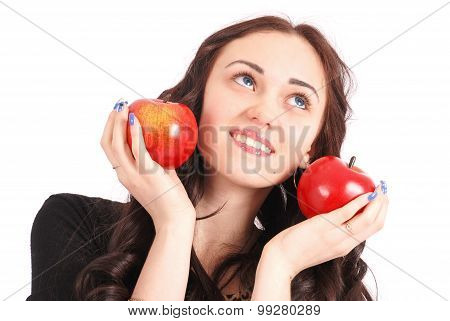 Teen Girl Holds Near The Face Apples
