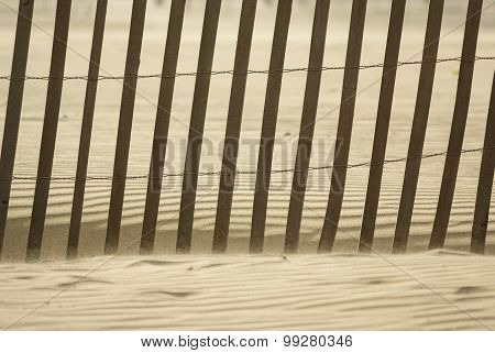 Wooden Fence On A Beach