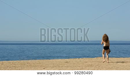 Young Woman Alone On A Beach