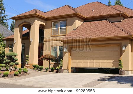 Open Garage Door In Suburban Family Home