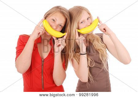 Two Beautiful Young Caucasian Girl With Banana Smile