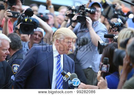 Donald Trump speaks with press