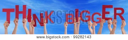 People Hands Holding Red Word Think Bigger Blue Sky