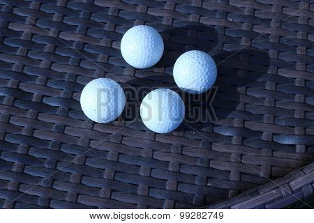Golf Ball On A Brown Background That Intertwine