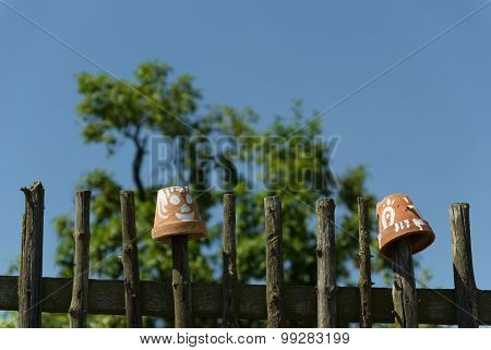 Simple Wooden Fence With Flowerpots