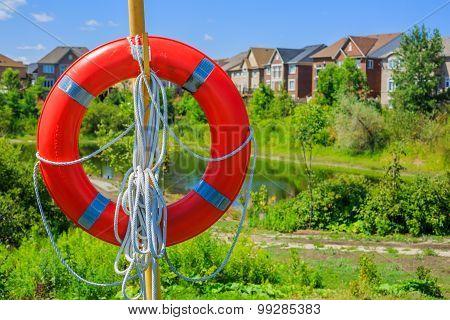 Lifebuoy on a background of luxury houses