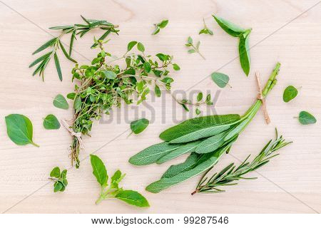 Fresh Green Herbs Harvest From Garden On Wooden Rustic Background .