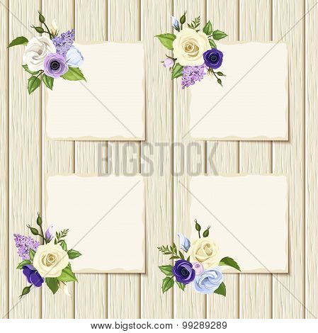 Cards with blue, purple and white flowers on a wooden background. Vector eps-10.