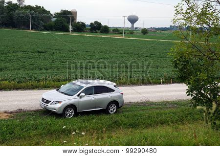 Lexus Parked on a Rural Road