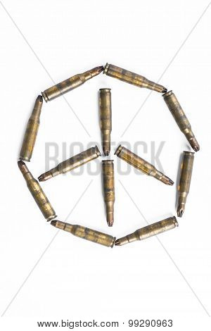 Peace symbol formed by old bullets, abstract concept