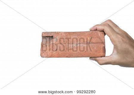 Hand holding old decay low quality brick, isolated on white background