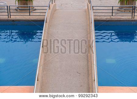 Stone Bridge Crossing On Swimming Pool