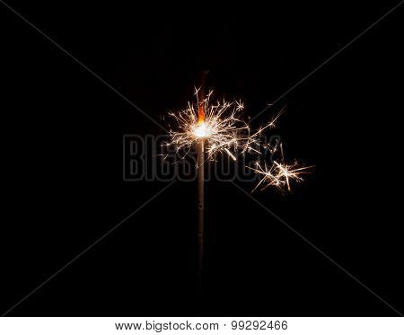 Hand Holding A Sparkler Fire On Black Background