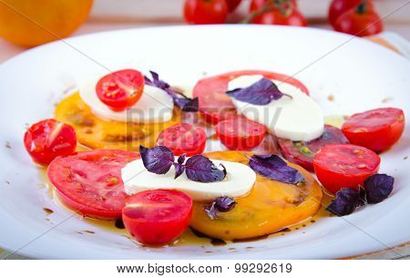 Caprese salad with tomatoes, mozzarella and basil.