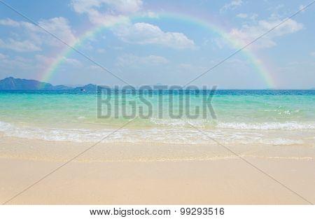 Colorful Rainbow Over A Tropical Beach Of Andaman Sea Thailand.