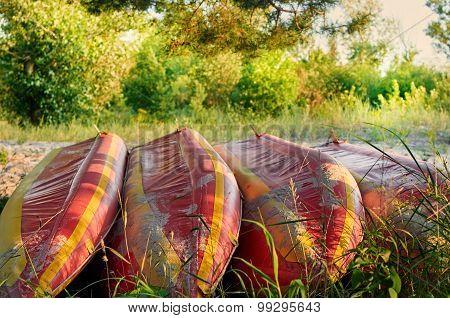 Kayaks on bank