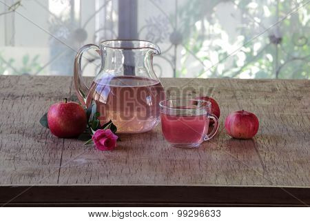 Apple Compote In A Transparent Jug, Fresh Apples And A Rose
