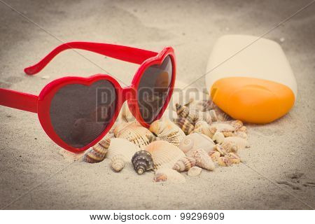 Vintage Photo, Seasonal Concept, Heap Of Shells, Sunglasses And Sun Lotion