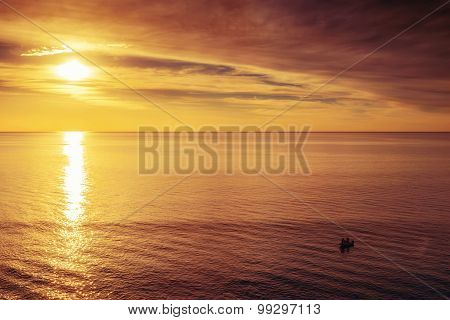 Boat With Fishermen At Sunset