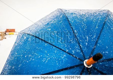 Blue Frozen Umbrella On The Snowy Storm Outdoors